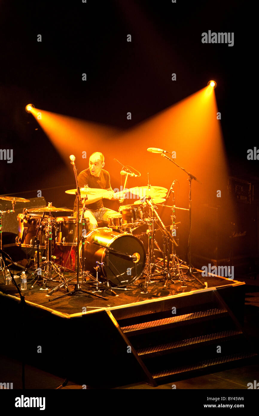 Drummer in rock and roll band on stage under white spotlights in Austin, Texas. First of four in series - Stock Image