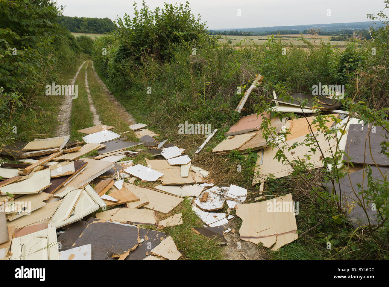 Fly tipping on public footpath Kent Ightham Stock Photo