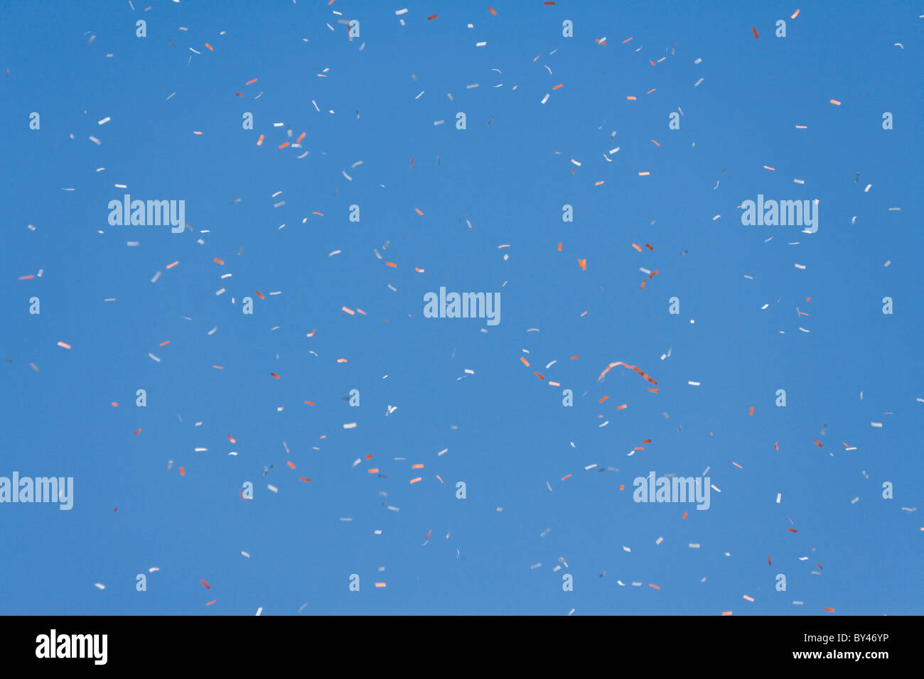 confetti and blue sky for background - Stock Image