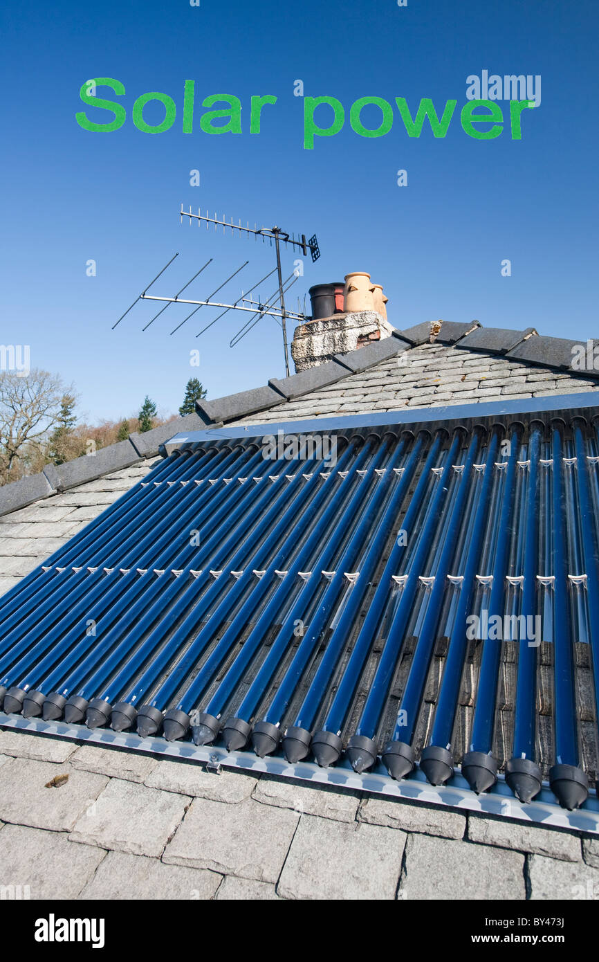 A soalr panel water heater on a house roof in Ambleside, Cumbria, UK ...