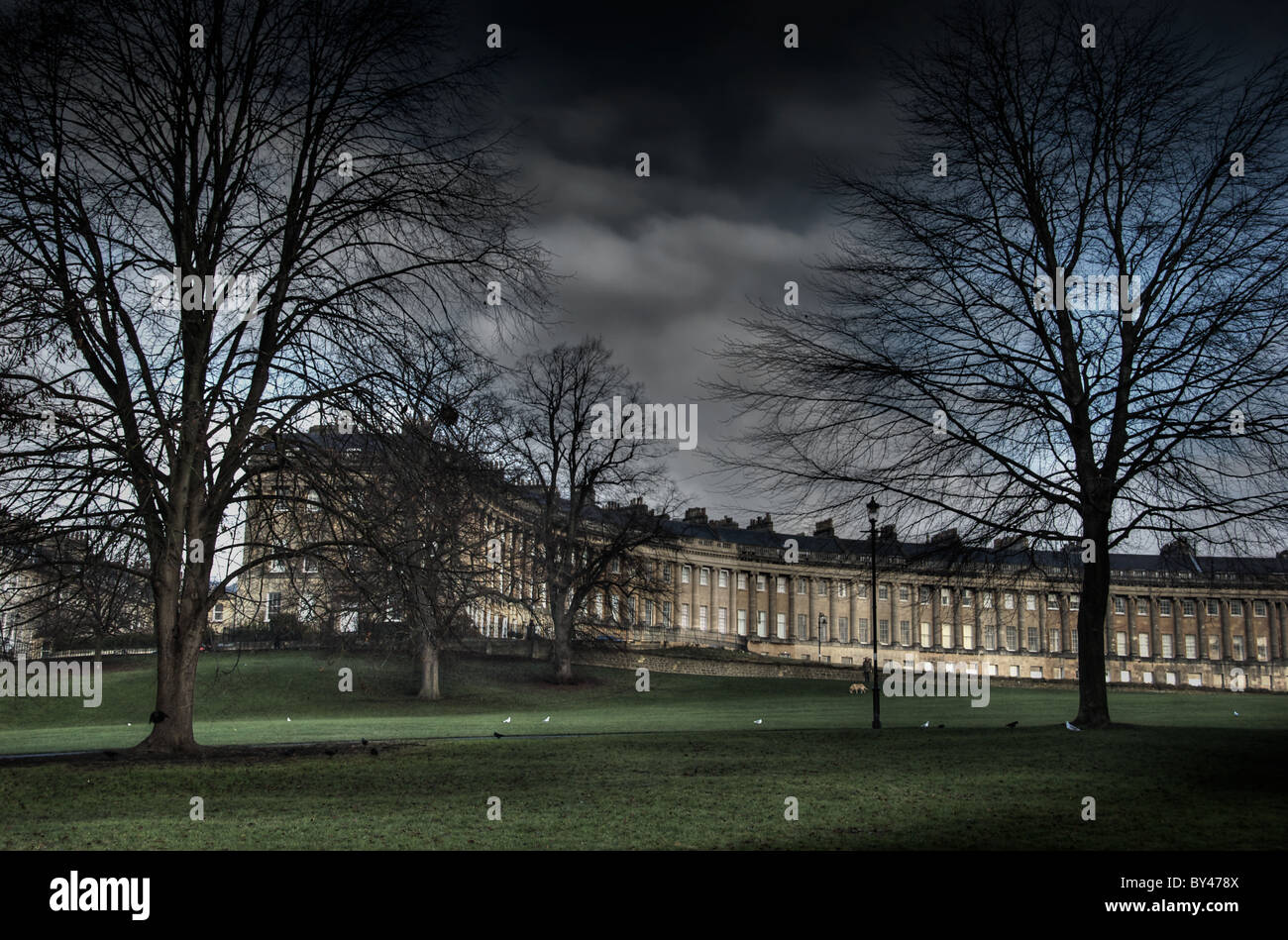The Royal Crescent at Bath England with parkland - Stock Image