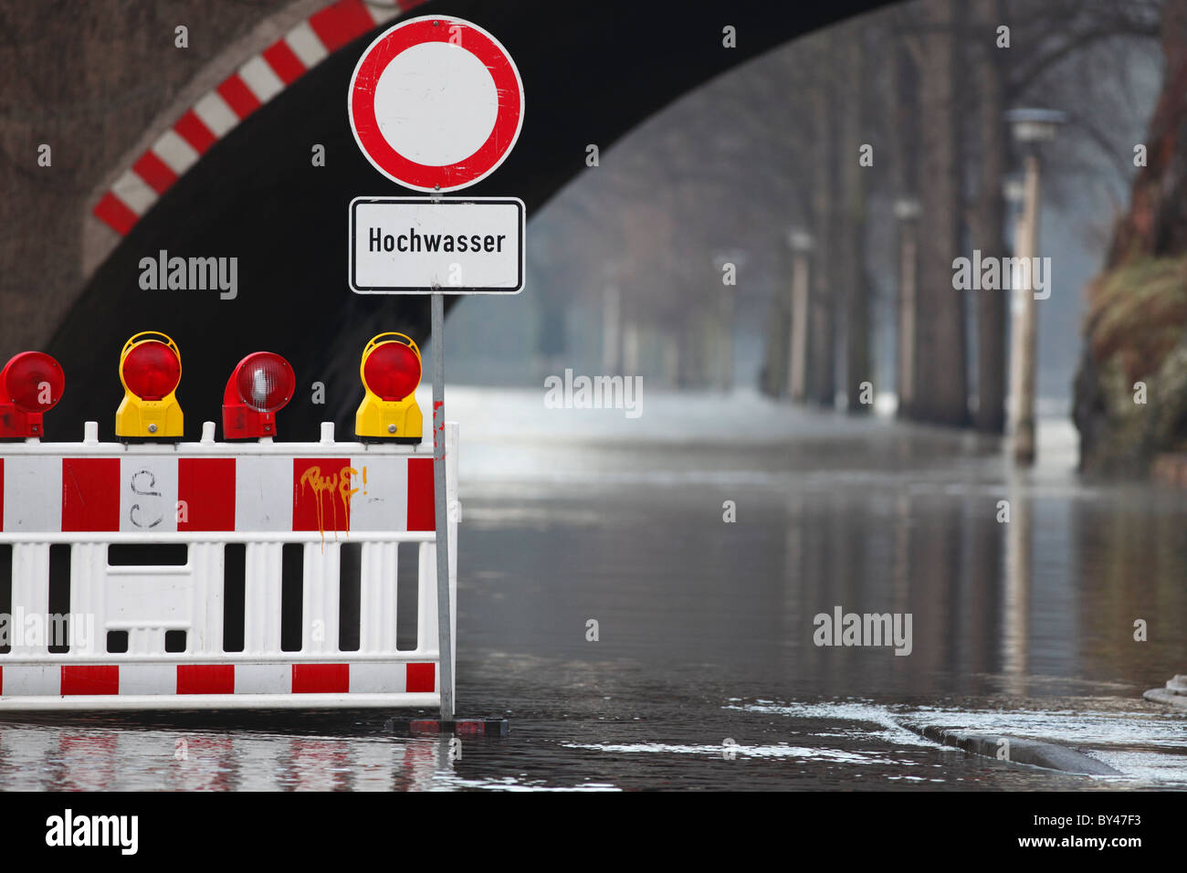 blocking the road because flooding of the river Saale in Halle (Germany) - Stock Image
