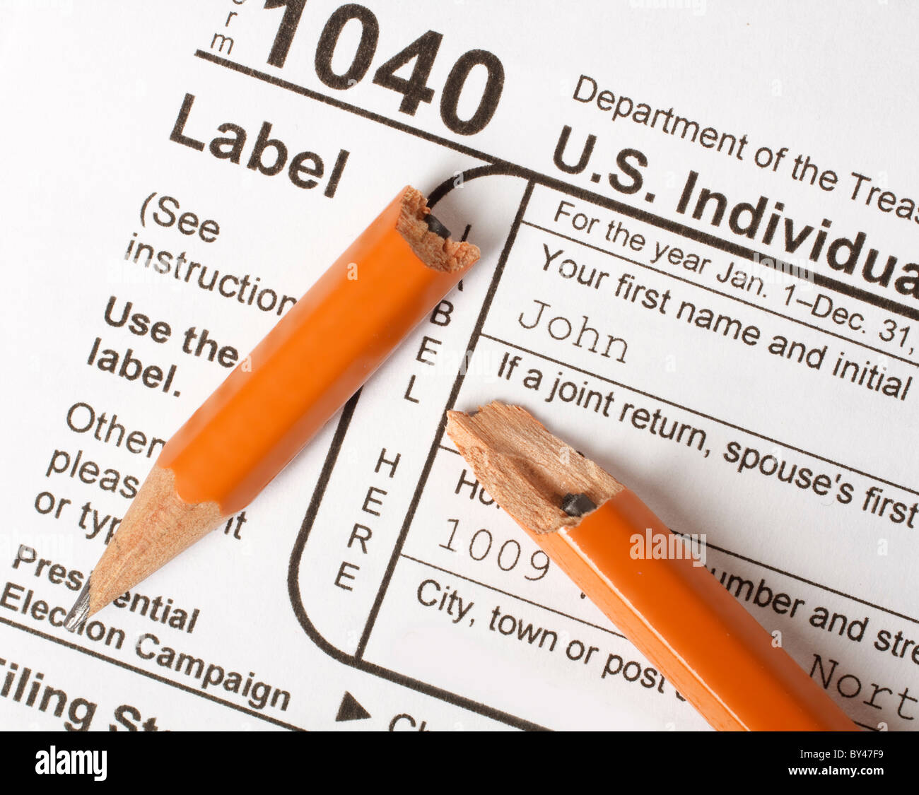 Broken pencil on a Federal 1040 Tax form illustrating the concept of taxpayer frustration and anger. - Stock Image