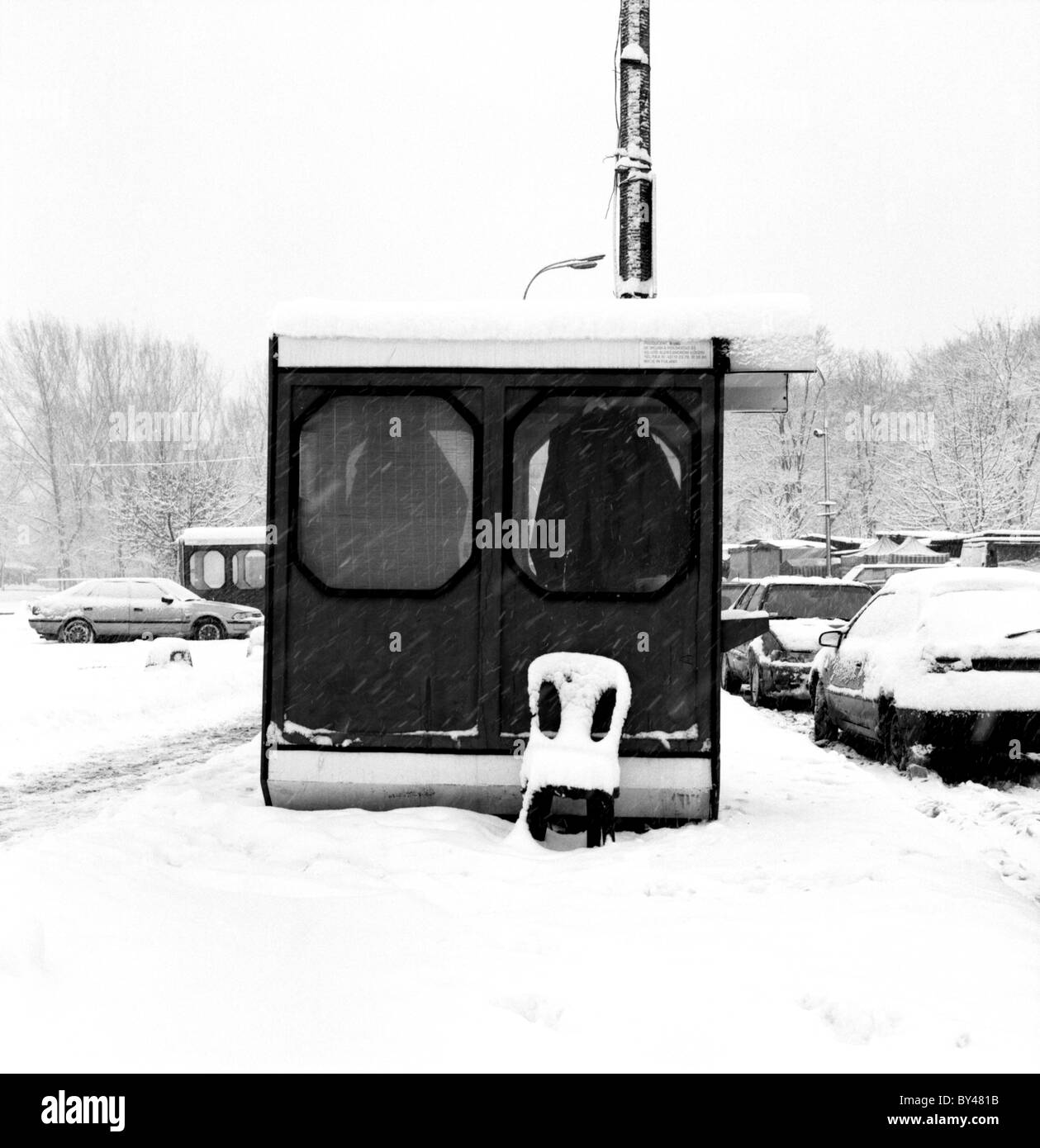 A chair left out in the snow in Warsaw. Poland Stock Photo