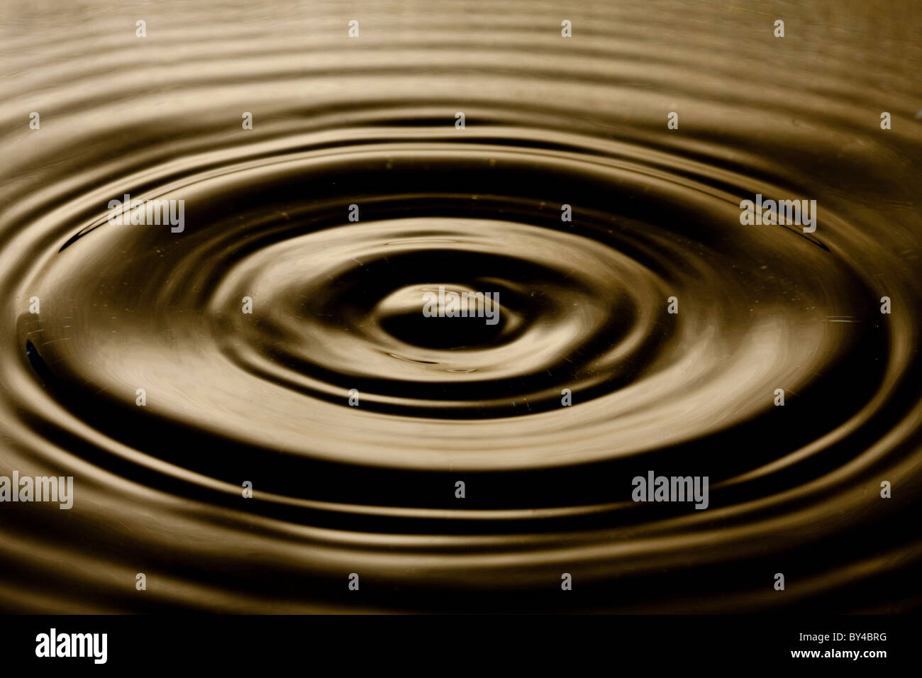 The disturbance of the water just as a water drop has his the waters surface. - Stock Image