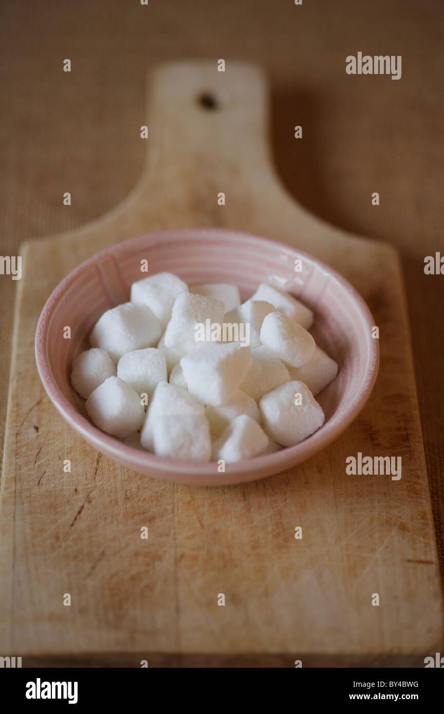 Sugar lumps in bowl - Stock Image