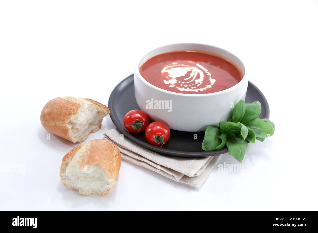 Tomato and Basil Soup with Crusty Roll - Stock Image