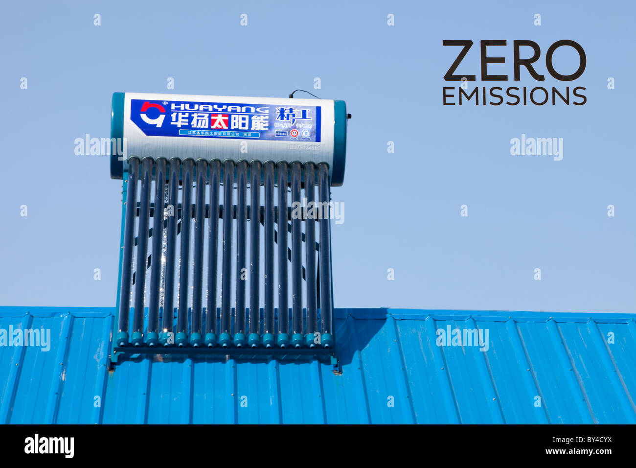 Solar water heaters on a house roof in China. - Stock Image