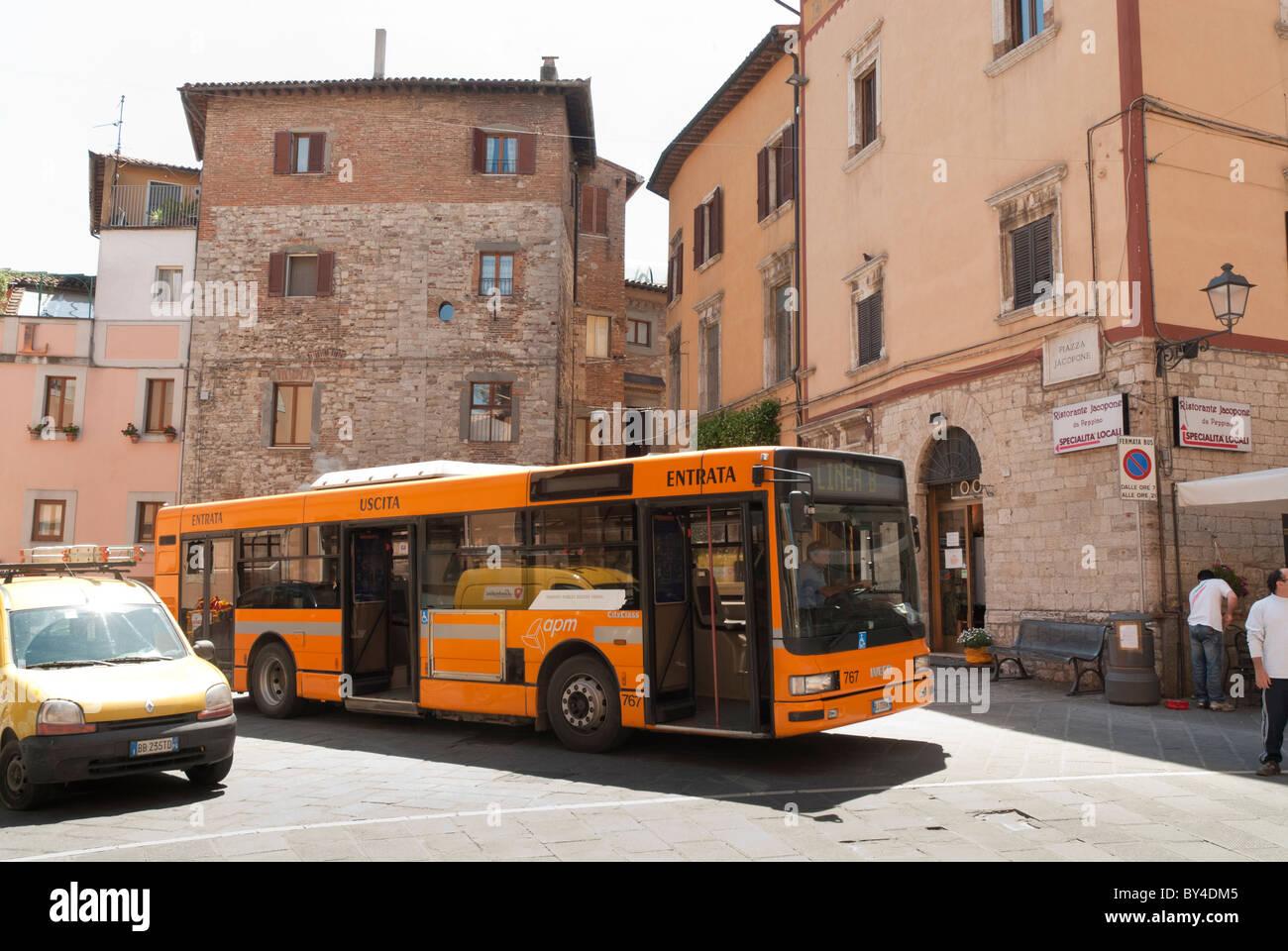 yellow single decker bus in Todi - Stock Image