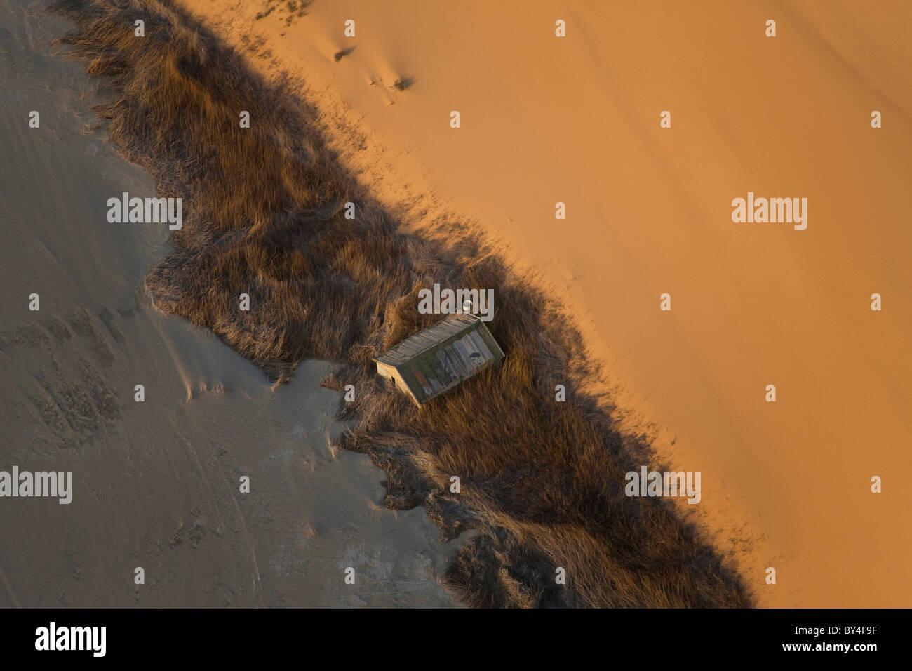 Hut buried by sand, Aerial view, Skelton Coast, Namib Naukluft Nat Park, Namib Desert, Namibia - Stock Image