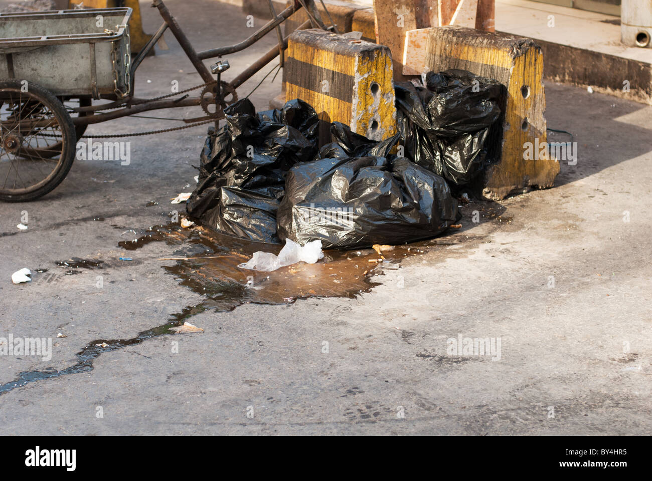garbage left on the street - Stock Image