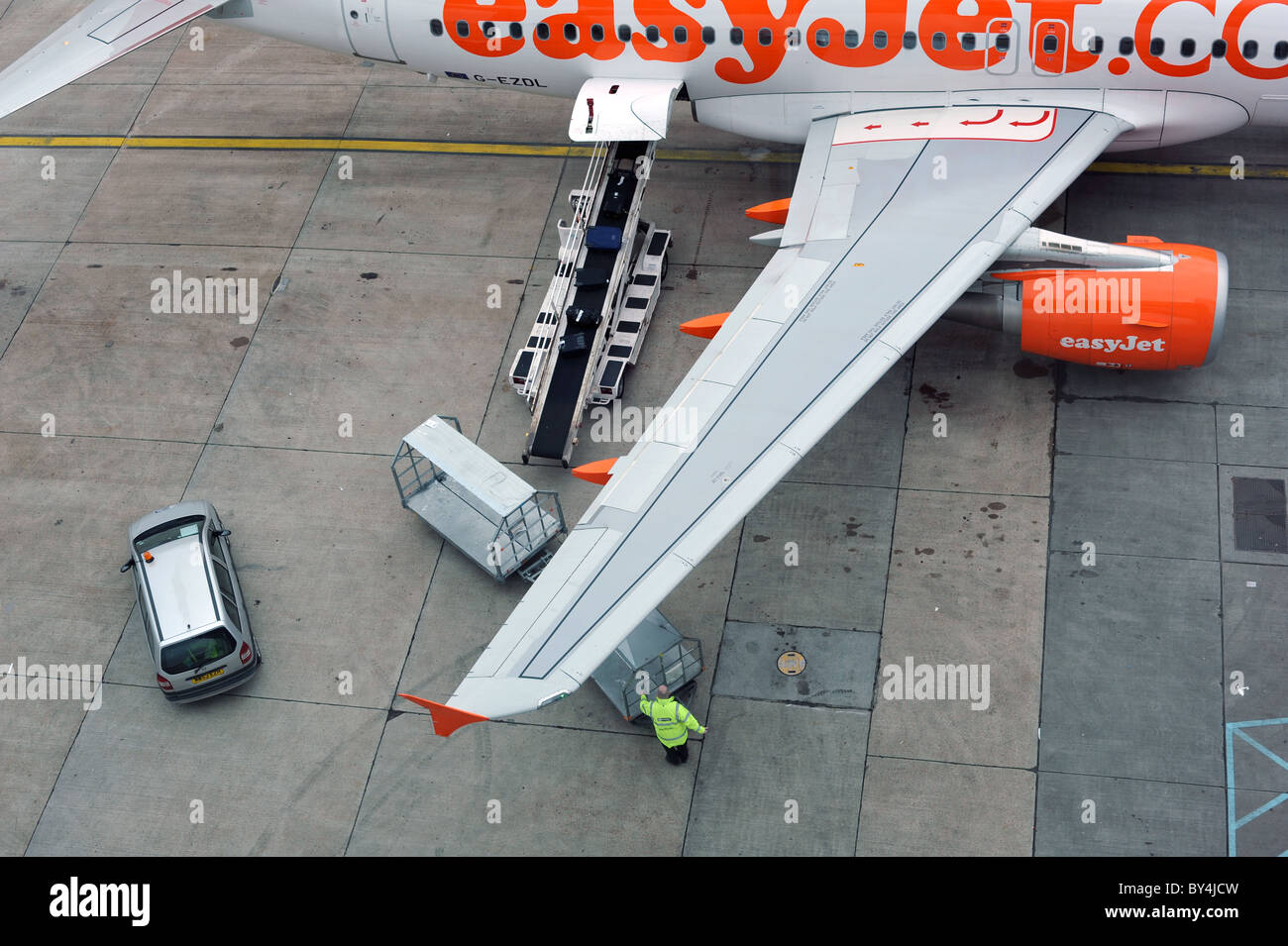 Airside baggage handling at Gatwick airport, UK - Stock Image
