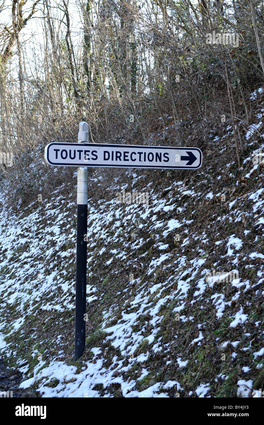 Toutes directions road sign in winter - France - Stock Image