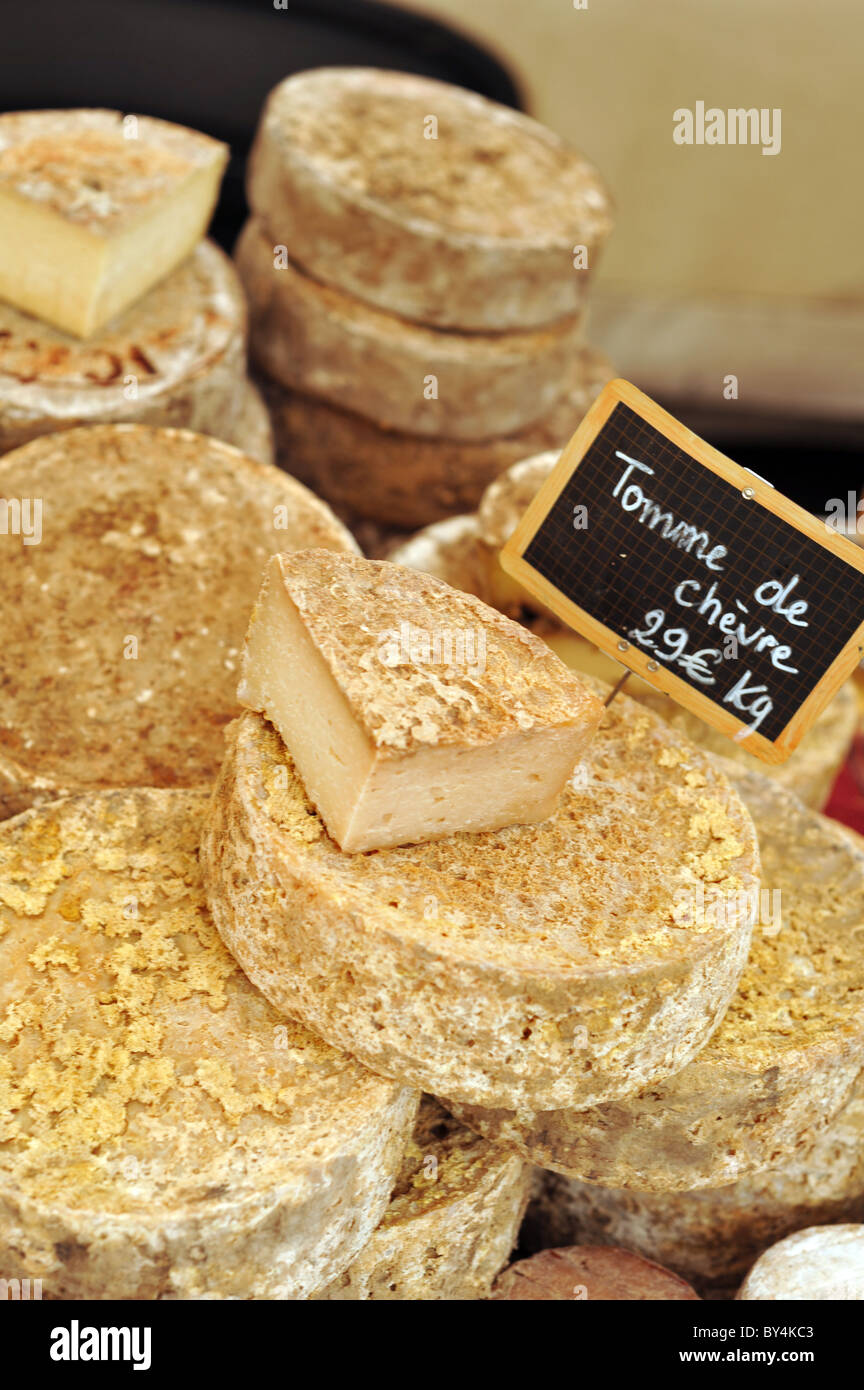 Tomme de Chevre cheese for sale at a French street market - Stock Image