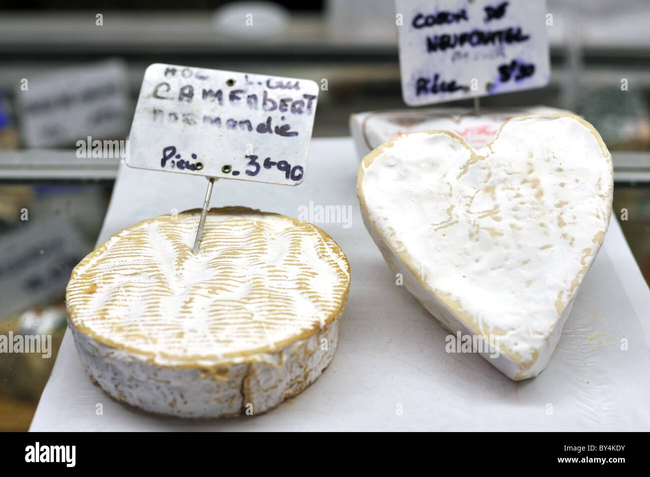 Normandy Camembert and Couer de Neufchatel cheeses for sale at a French street market - Stock Image