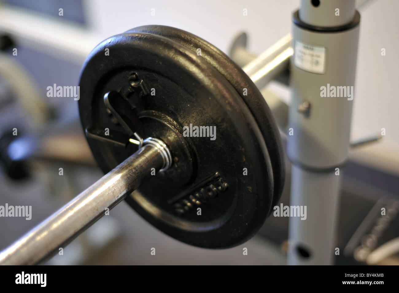 Dumbbell weights placed on the rest at the gymnasium - Stock Image