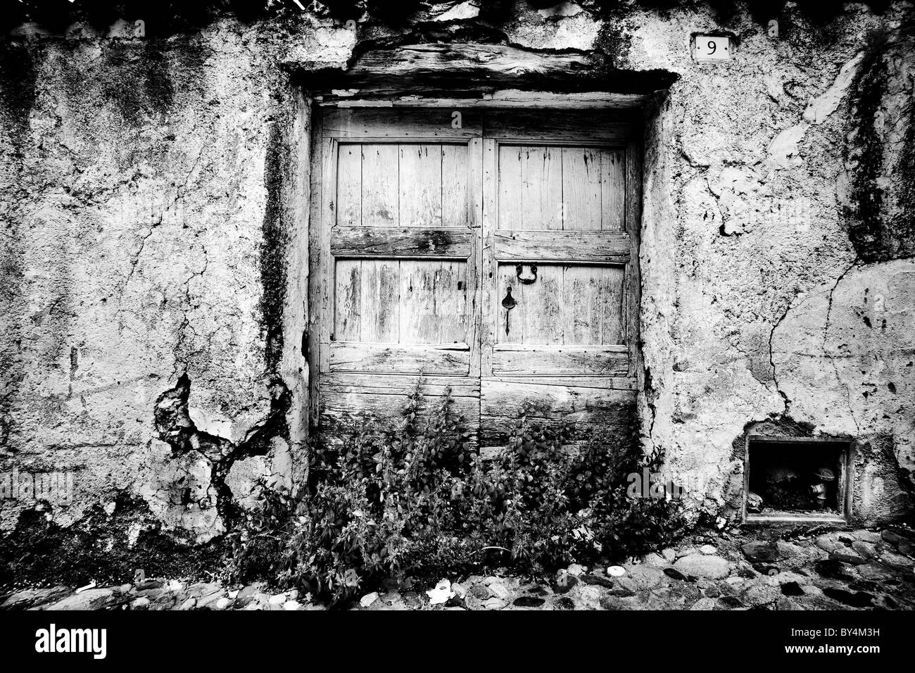 Run-down doorway, Oliena, Sardinia, Italy - Stock Image