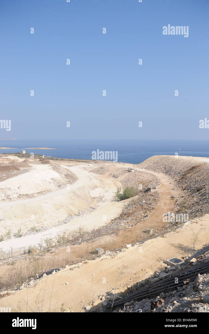 A section of a large stepped landfill in Malta - Stock Image