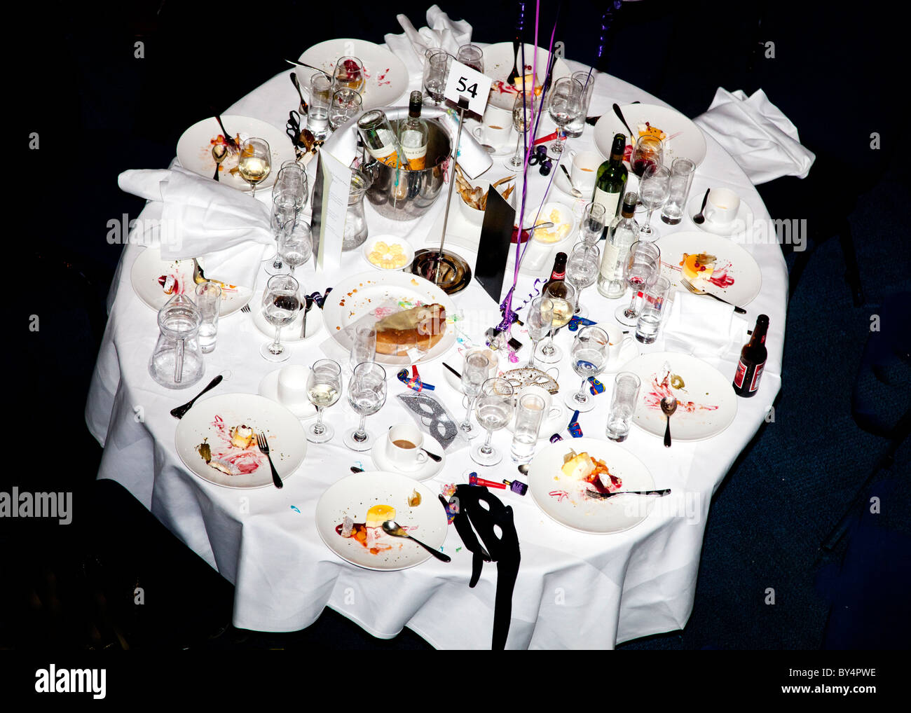 The morning after. A dinner table covered in the after effects of a party. - Stock Image