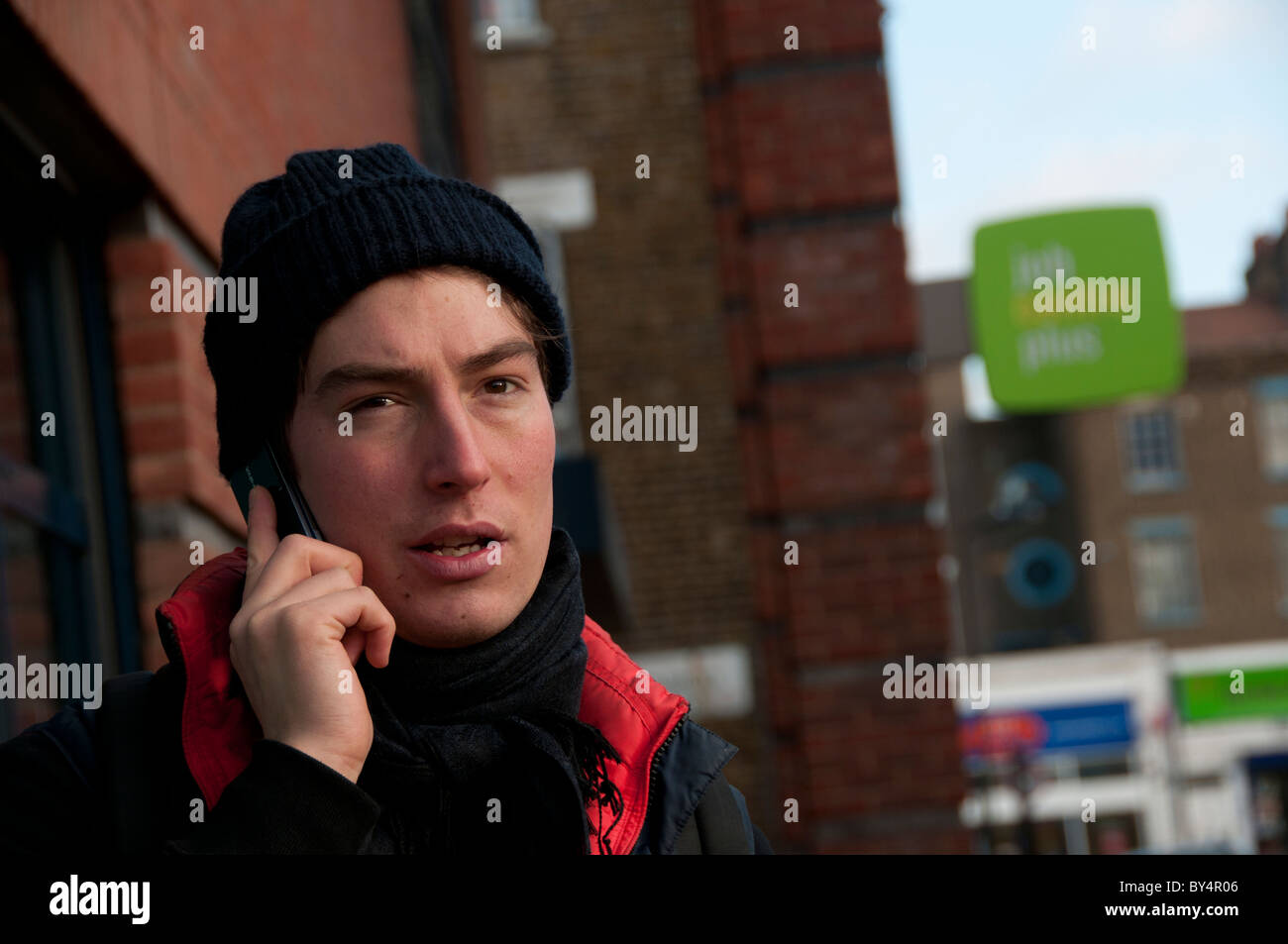 Hackney economic crisis.Young man looking for work outside job centre plus - Stock Image