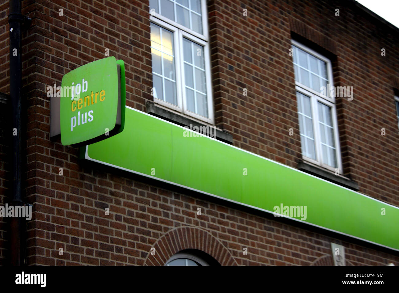 A job centre plus brick building showing their brand and logo on the front of the branch. Stock Photo