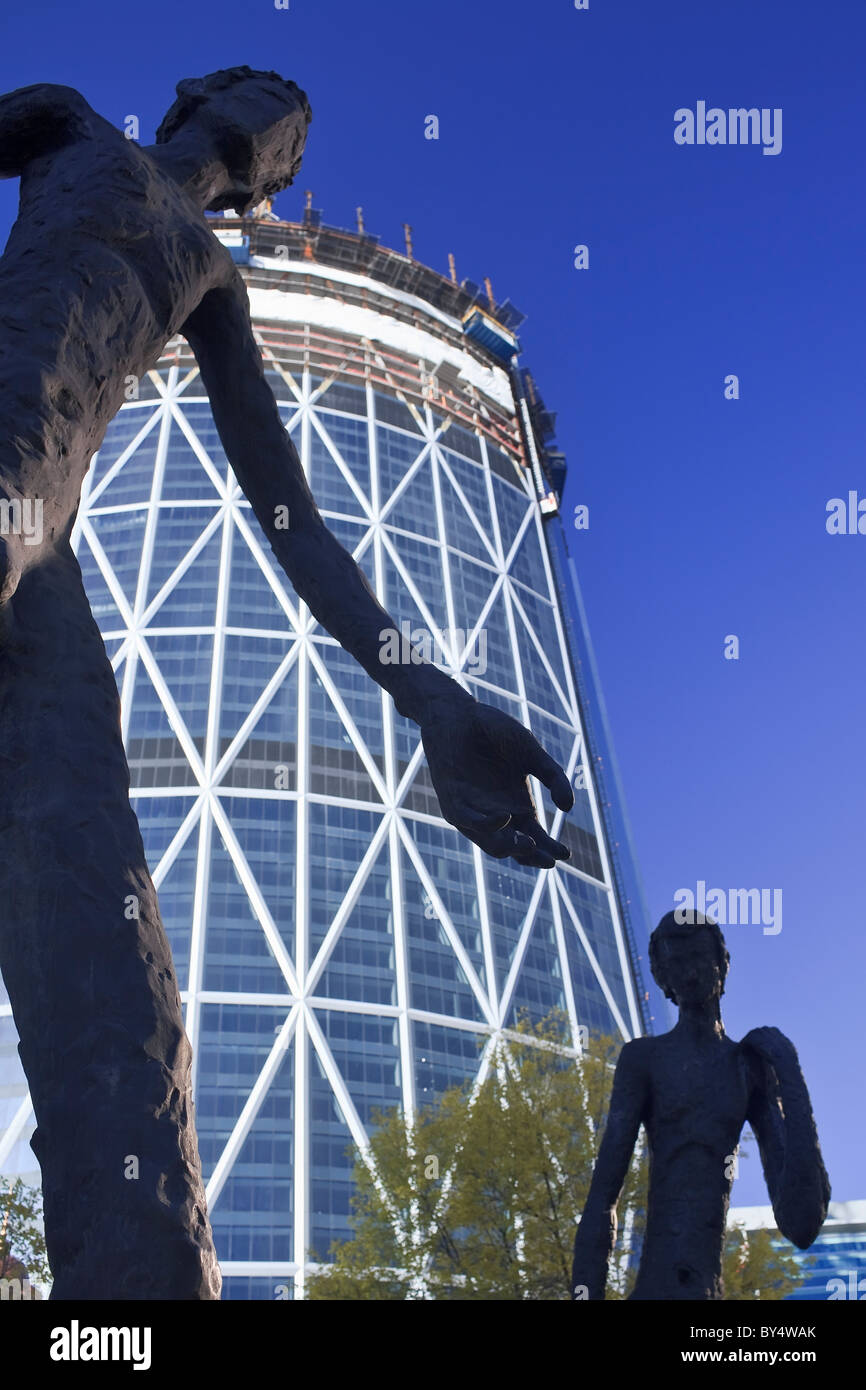 Family of Man sculpture and The Bow building, Calgary, Alberta, Canada. - Stock Image
