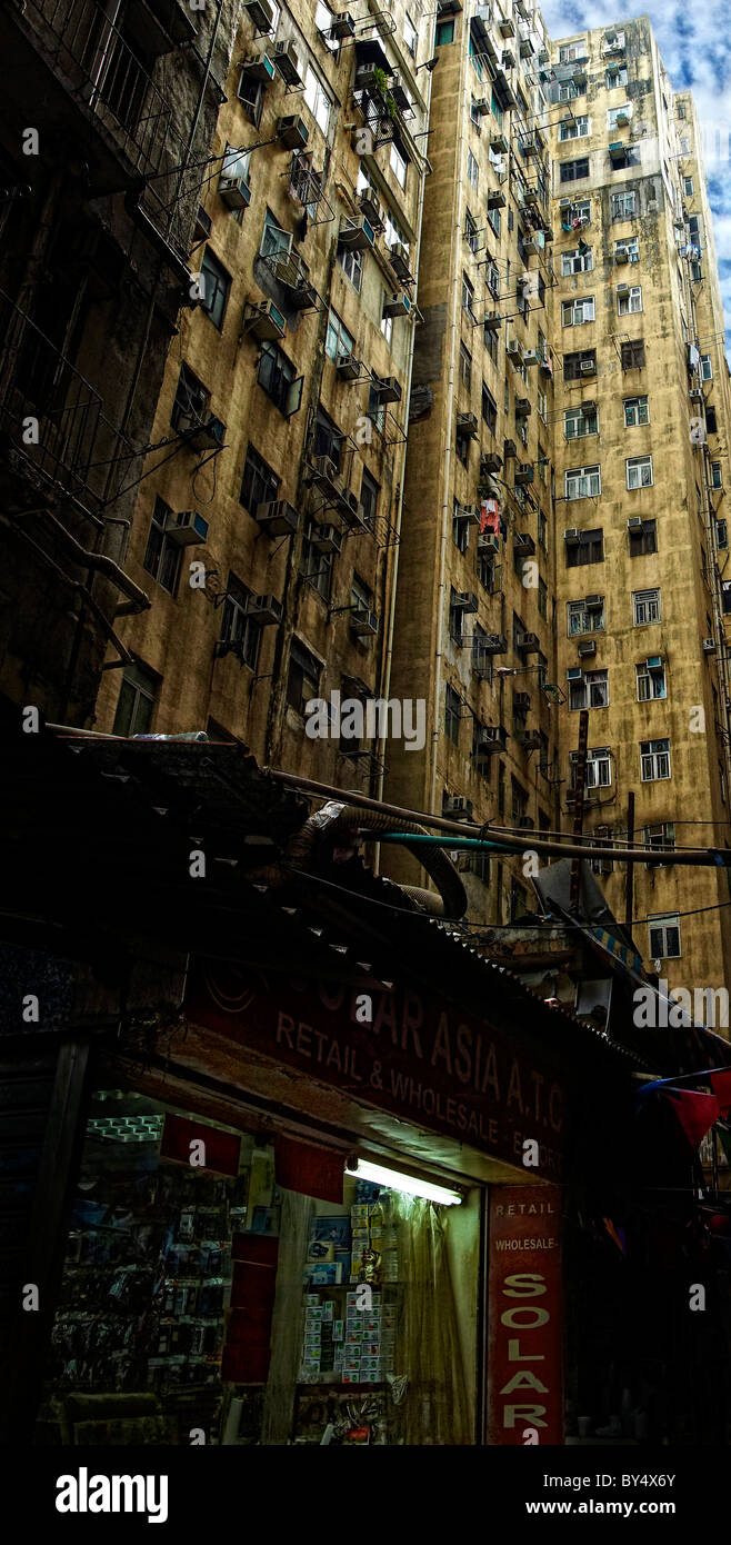 'Solar' electrical shop and Hong Kong high rise apartments - Stock Image