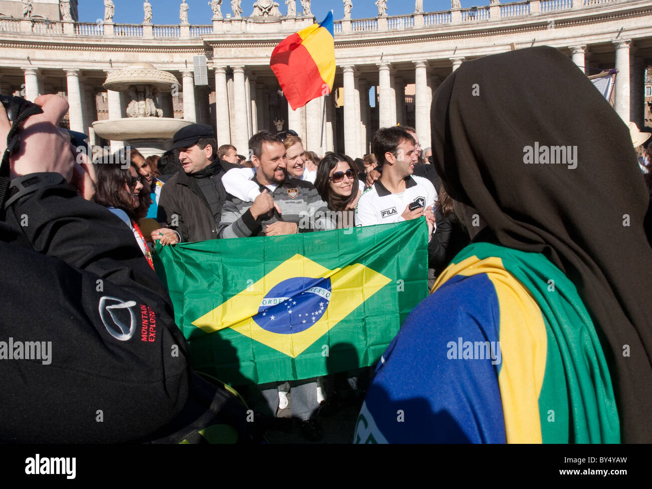 """people crowd for """"Migrant day"""" migrant celebration in Vatican St Peter's square Brazil Brazilian flag people community Stock Photo"""