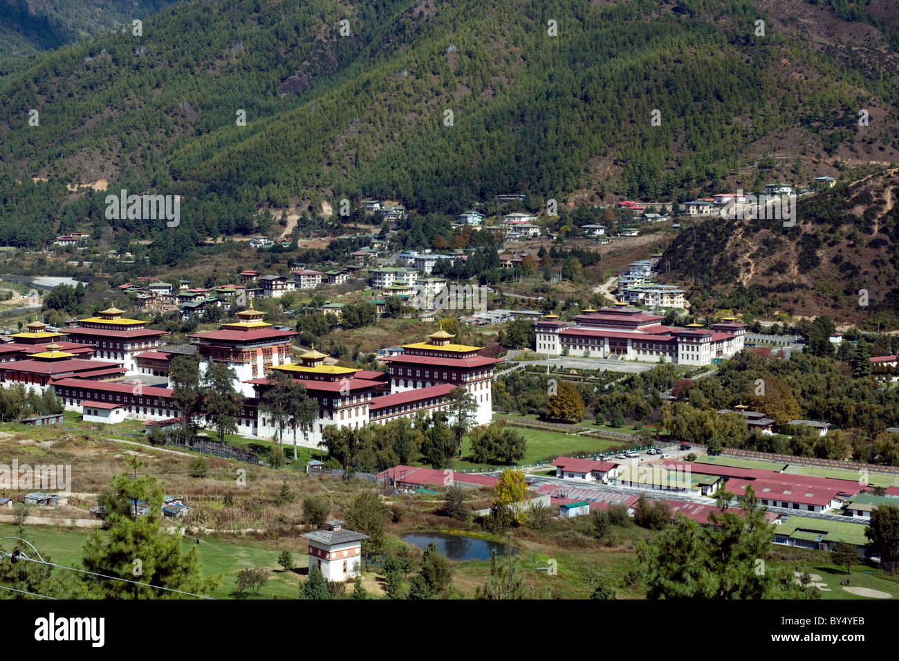 Government in Thimpu, Bhutan's capital, is in the great gold-capped dzong, or fortress, left., with Parliament - Stock Image