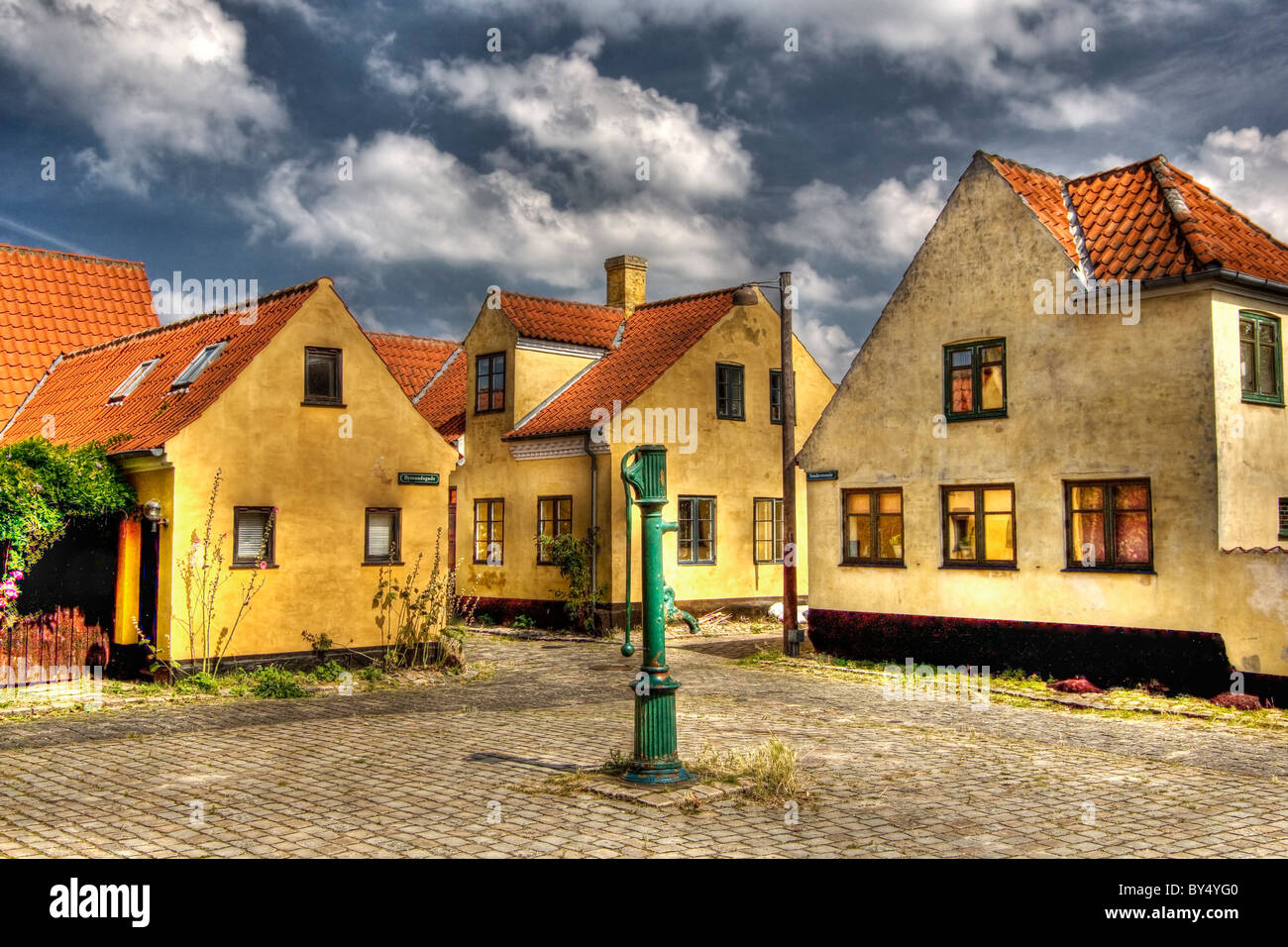 Beautiful yellow houses in the village Dragor in Denmark - Stock Image