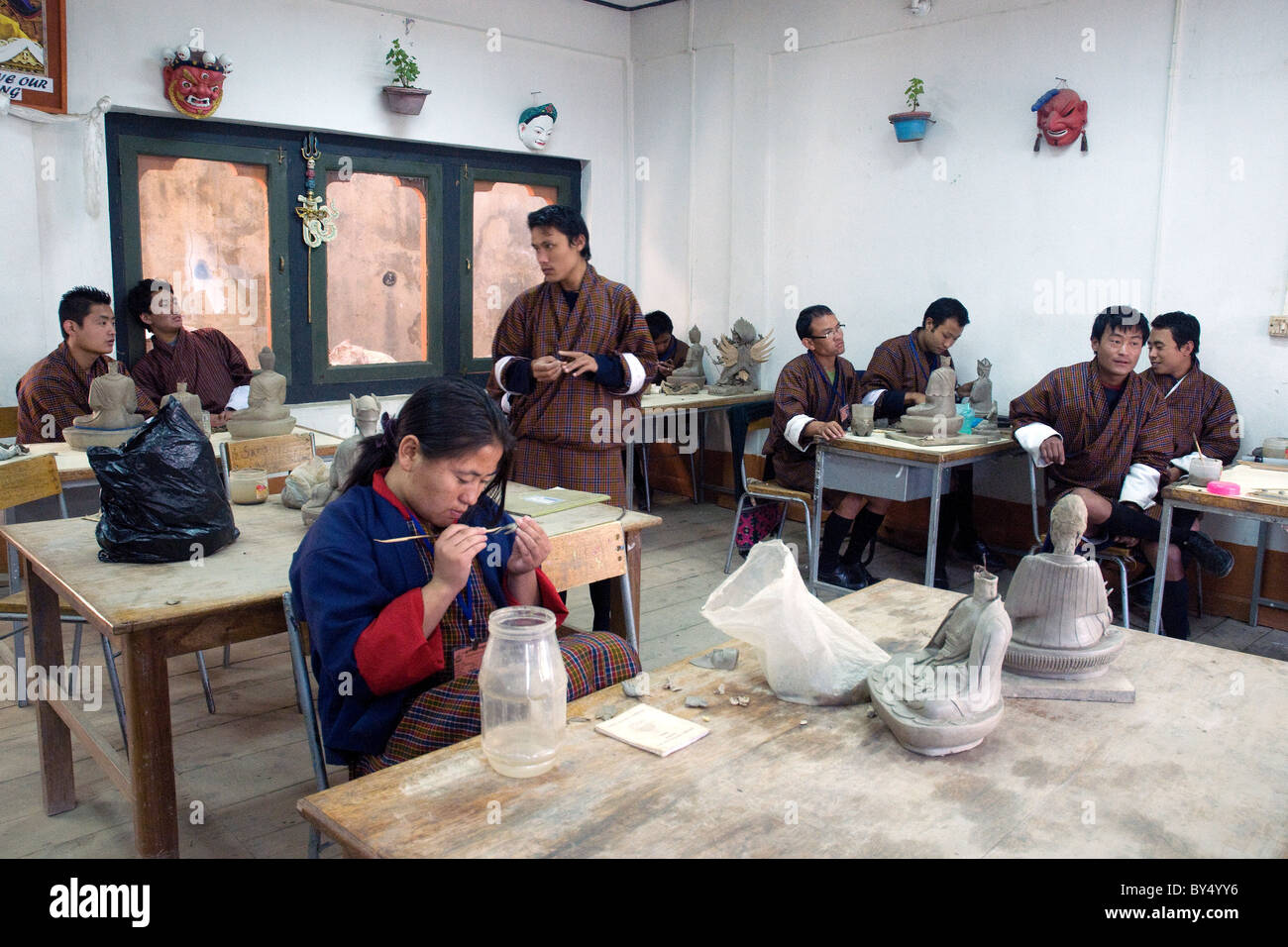 In Bhutan's national art and handicraft school in Thimpu, youngsters learn arts and crafts in the broadly Tibetan - Stock Image