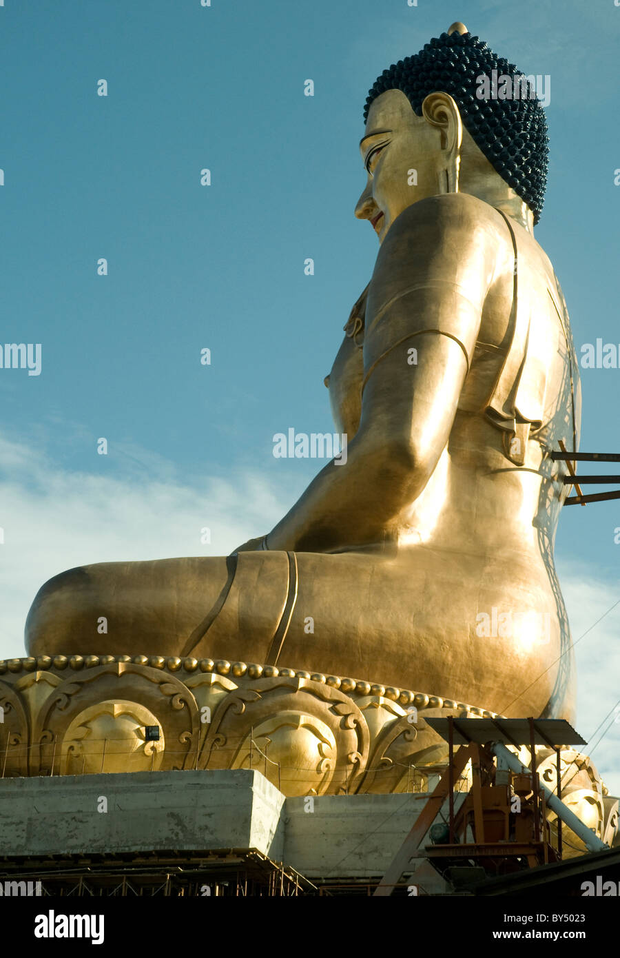 On a hill outside Bhutan's capital, Thimpu, a 162-foot-high Buddha is a gleaming feature of the landscape - Stock Image