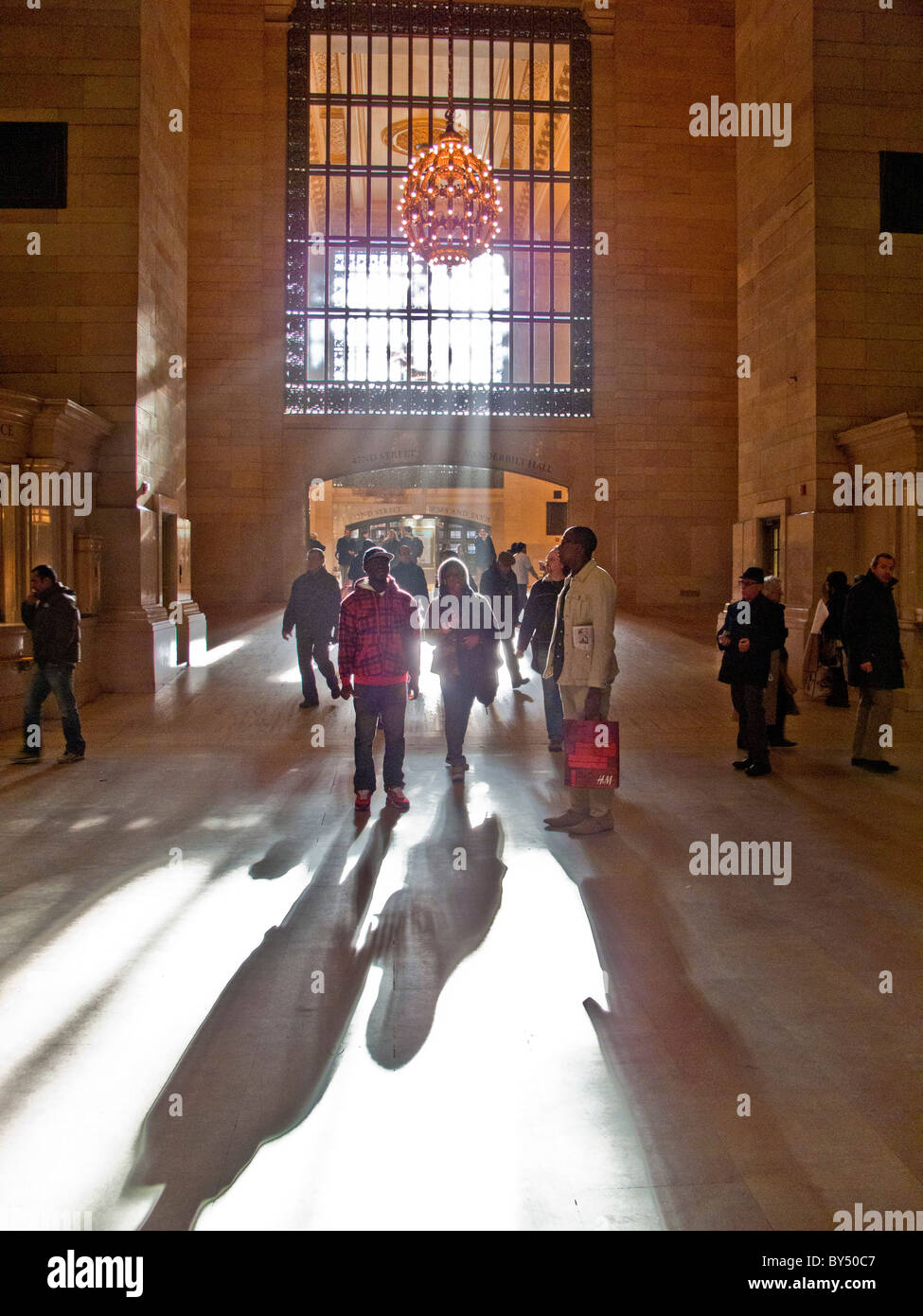 In afternoon sun, travelers ask directions the 42nd Street exit of Grand Central Station in midtown Manhattan, New - Stock Image