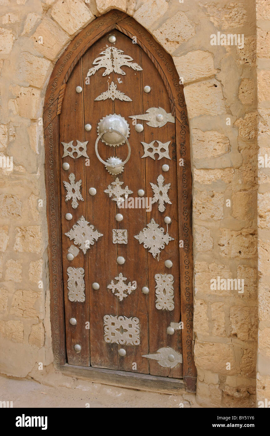 One Of The Decorated Wooden Doors Of The Sidi Yéhia Mosque In Timbuktu,  Mali.