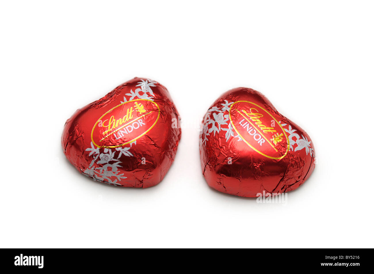 Pair of heart shaped chocolates - Stock Image