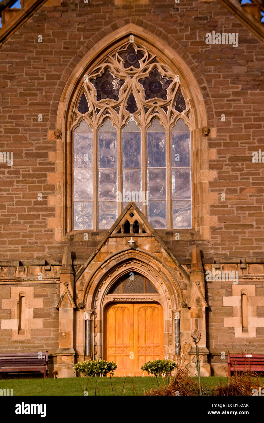 Reflections on the huge arched windows above the main entrance of the1870 Lochee Parish Church in Dundee,UK Stock Photo
