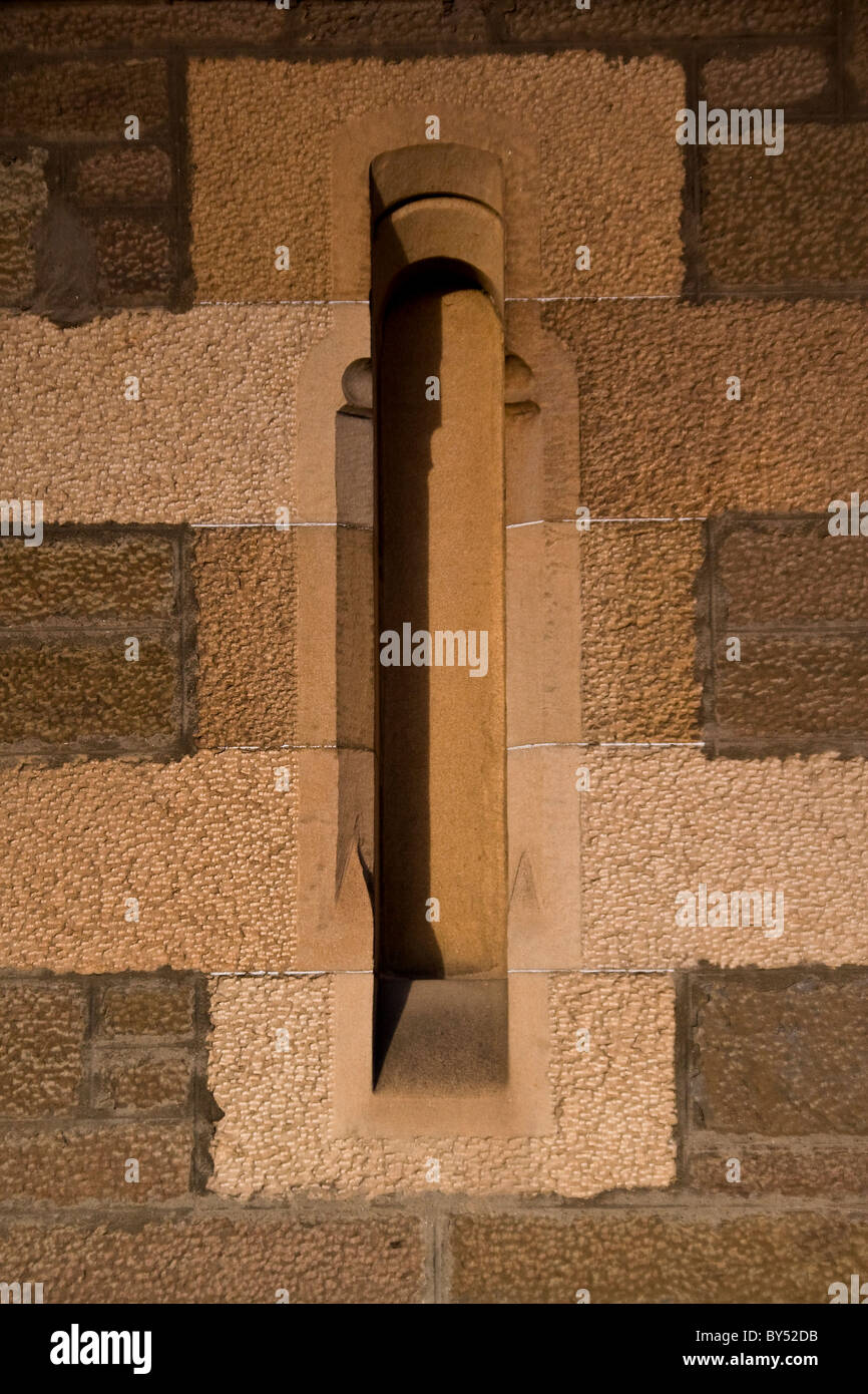 An archers viewpoint on the front wall of the 1800`s Lochee Parish Church in Dundee,UK - Stock Image