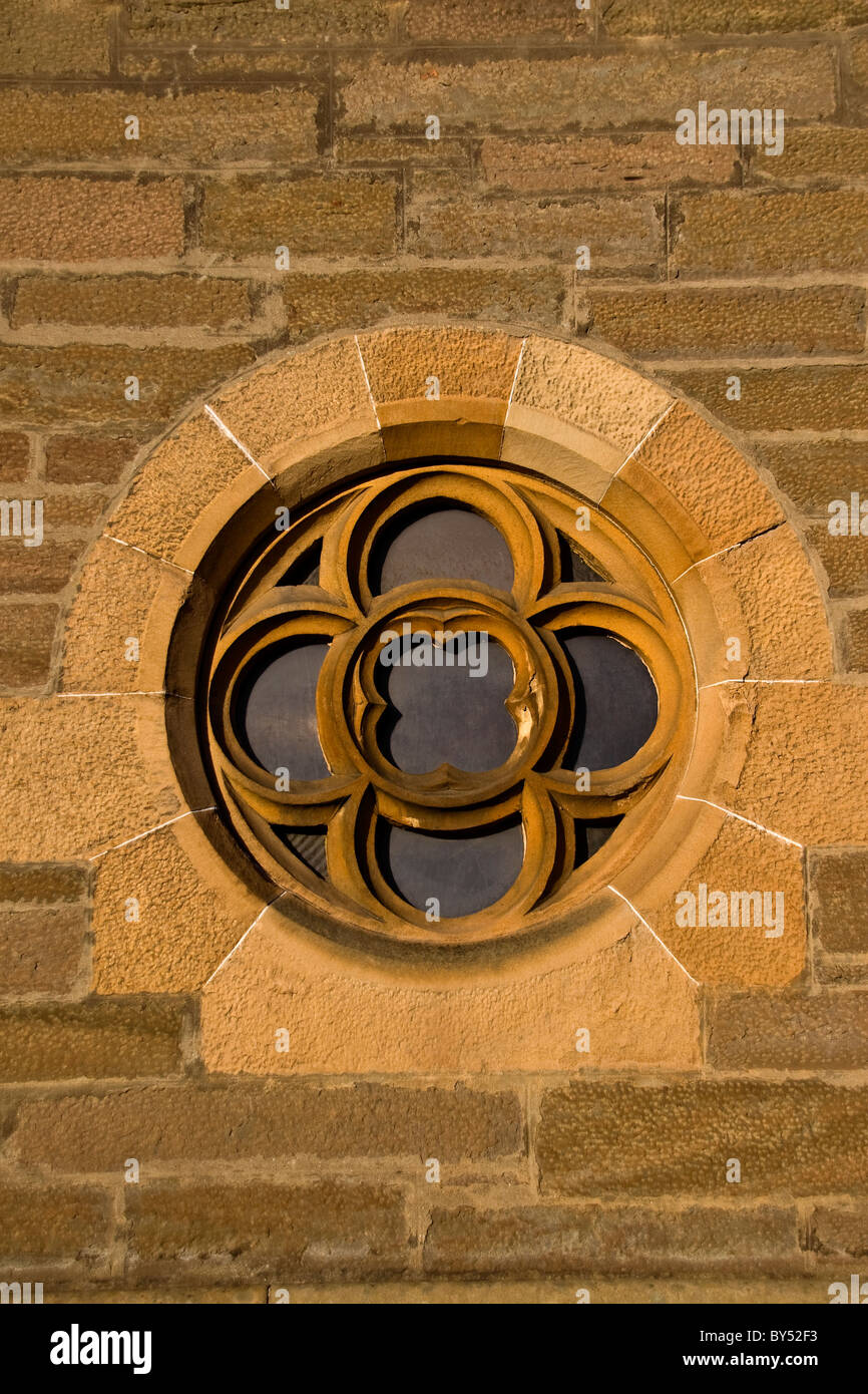 A small circular etched window at the front of the 1800`s Lochee Parish Church in Dundee,UK - Stock Image