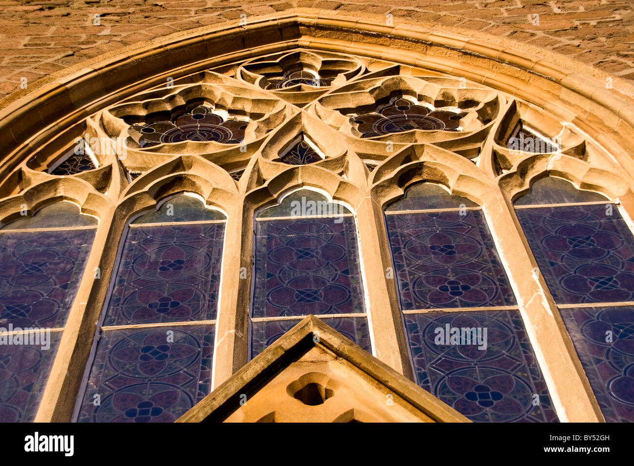 Large 1800`s arched Gothic style windows of the Lochee Parish Church in rural Dundee,UK - Stock Image