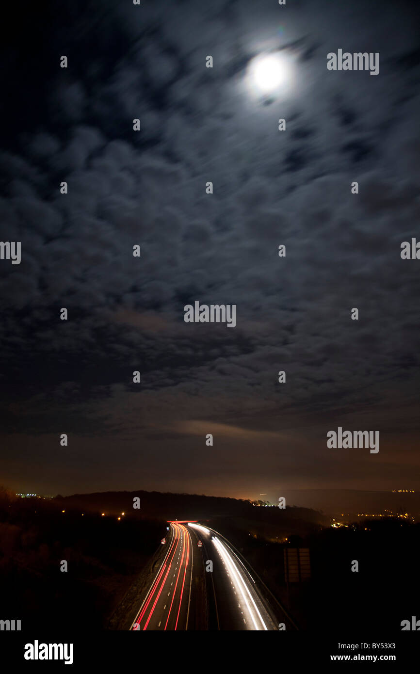 A27 dual carriageway at night with car headlights and tail lights leaving trails along the road. - Stock Image