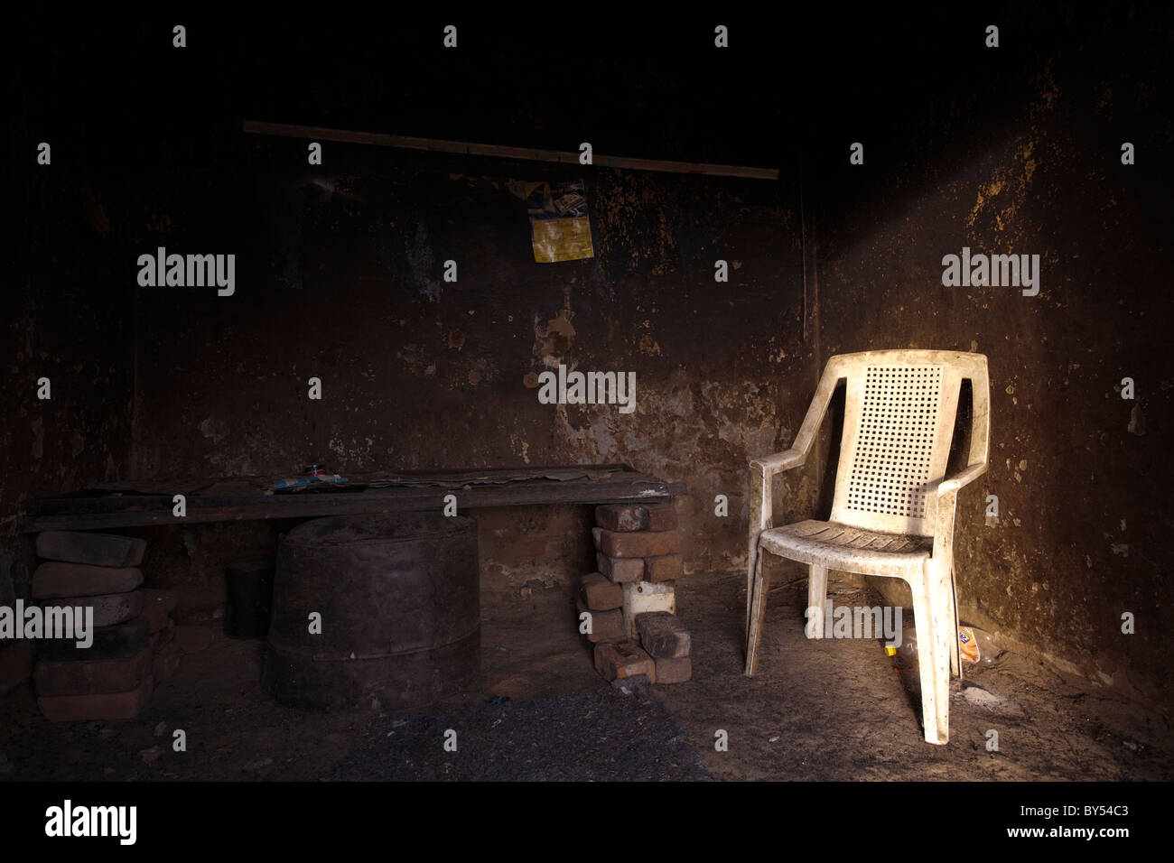 A chair in a shack used by temporary labourers on a Karoo farm. - Stock Image