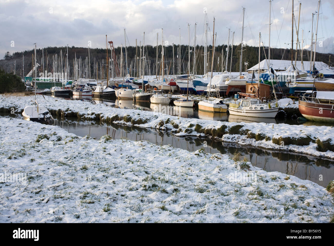 Snow on the ground at the boatyard in Gweek, Cornwall - Stock Image