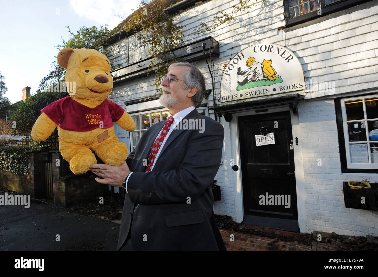 Mike Ridley owner of Pooh Corner a shop in Hartfield selling all kinds of Winnie the Pooh memorabilia - Stock Image
