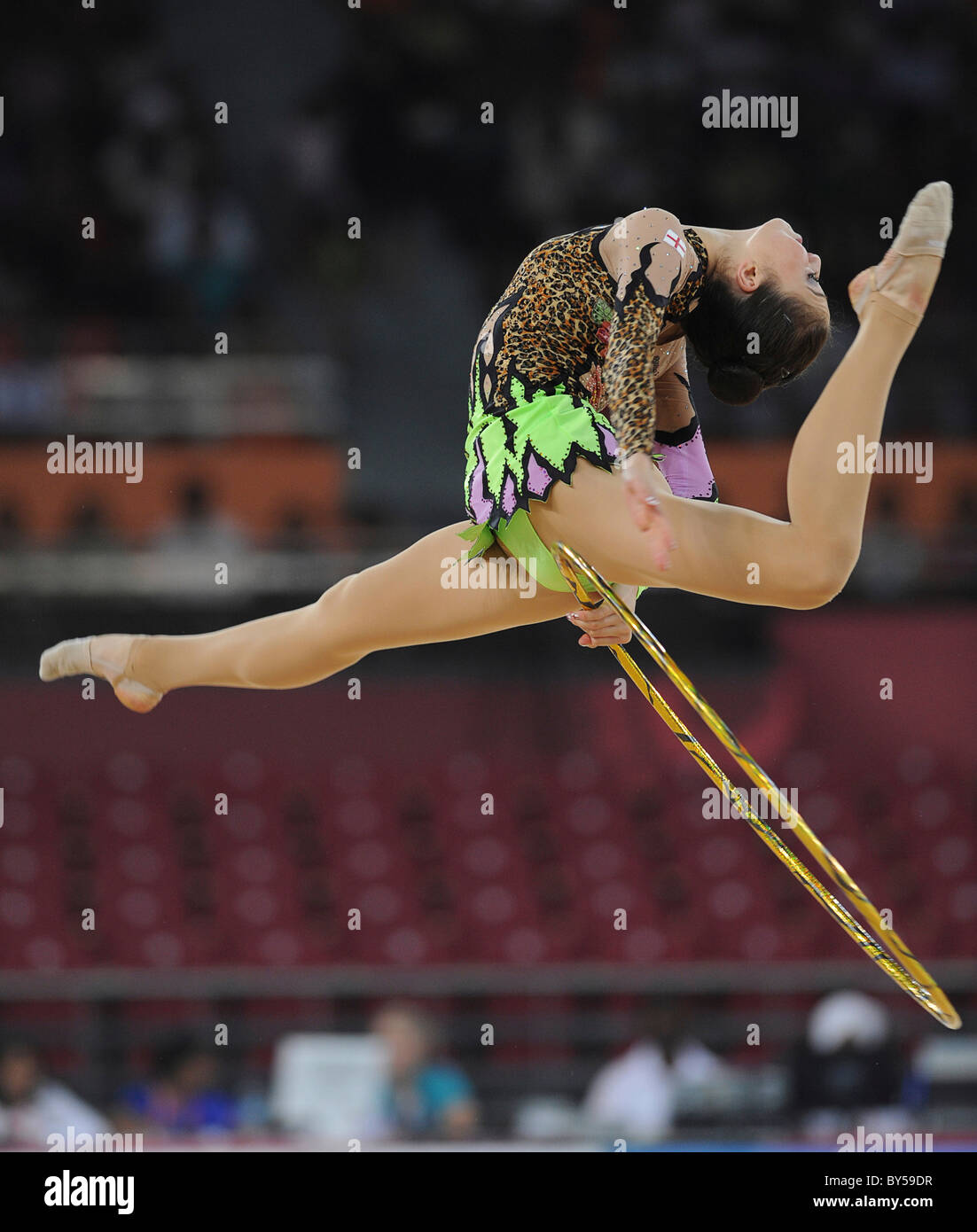 India Delhi 2010 XIX Commonwealth Games Rhythmic gymnastics. Gymnast and hoop. - Stock Image