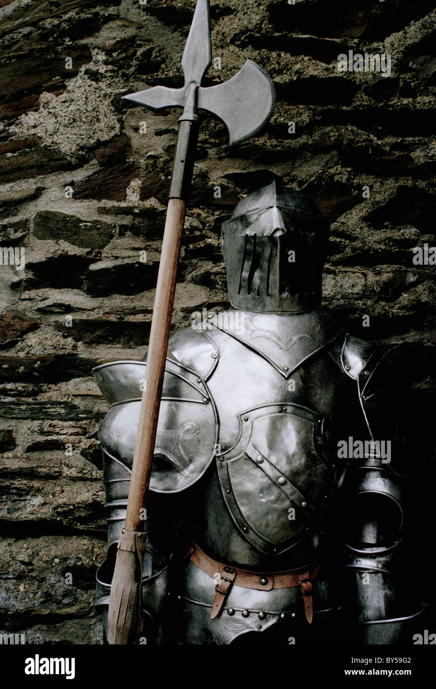 Suit of armor with an axe - Stock Image