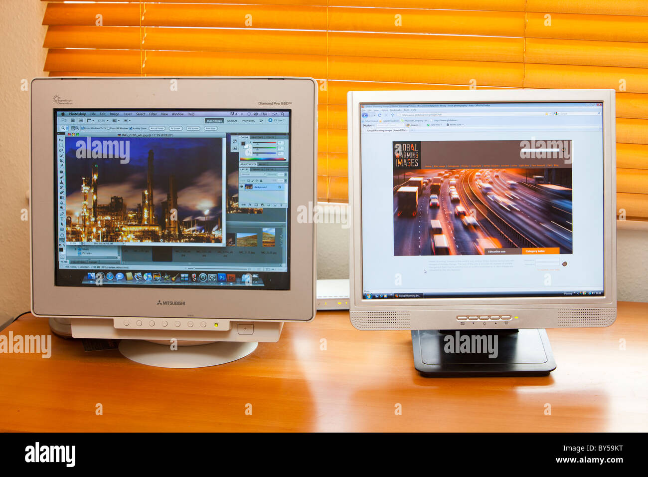 Computer monitors using energy. - Stock Image