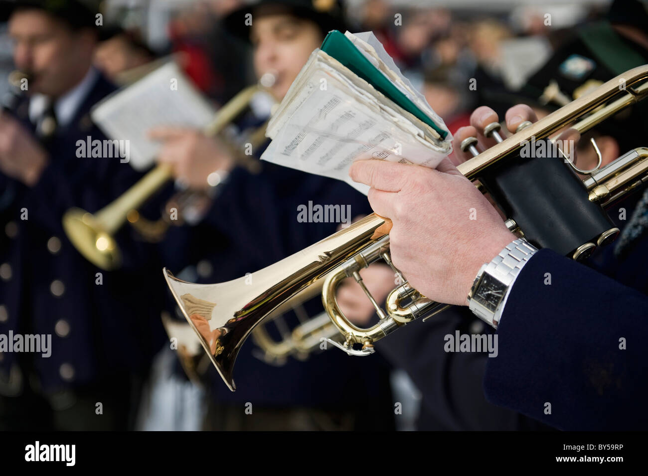 Person playing a trumpet in a marching band - Stock Image