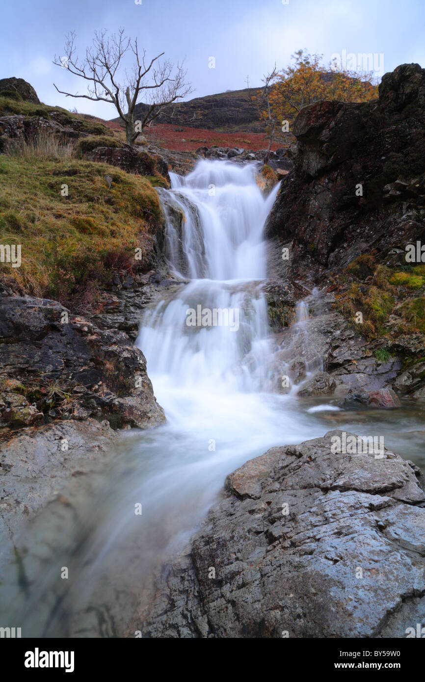 Comb Beck waterfall on the Southern Shore of Buttermere, English Lake District. - Stock Image