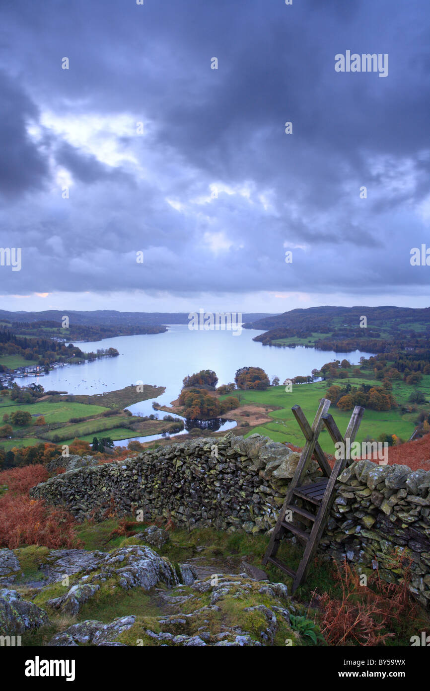 Todd Crag, Wall stile and Lake Windermere stretching into the distance, English Lake District. - Stock Image