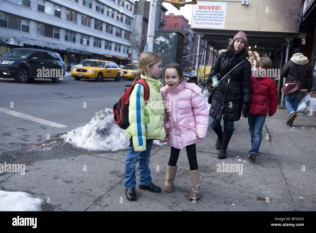 Children going home after school, Manhattan, New York City. - Stock Image